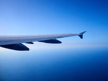 Airplane flying above clouds Stock Photography