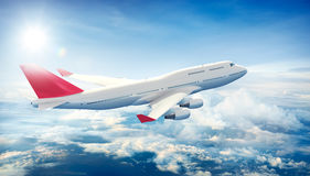 Airplane flying above clouds Royalty Free Stock Image