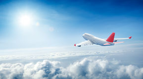 Airplane flying above clouds. 3D Rendering Stock Photo