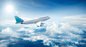Airplane flying above clouds Royalty Free Stock Images
