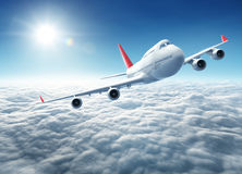 Airplane flying above clouds. 3D Rendering Royalty Free Stock Image