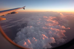 Airplane flying above clouds Royalty Free Stock Photos