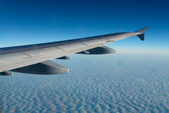 Airplane flying above clouds Stock Photo
