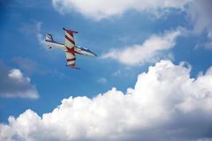Airplane flying above clouds Stock Photos