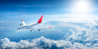 Airplane flying above clouds. On sunny day Vector Illustration