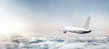Airplane flying above clouds at sunrise. 3D Rendering Vector Illustration