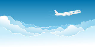 Airplane flying above the clouds Stock Images