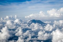 Airplane flying above Mount Agung volcano, Bali, Indonesia
