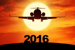 Airplane flying above numbers 2016 Royalty Free Stock Image