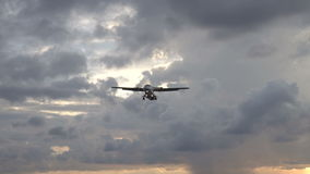 Airplane flying above the sea over cloudy sky stock video footage