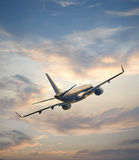 Airplane flying above  sunset Royalty Free Stock Images