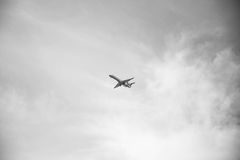 Airplane Flying on Air in Grayscale Photography Stock Photo