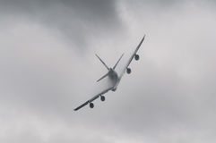 Airplane flying in bad weather Stock Photography