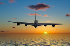 Airplane flying into a beautiful sunset stock photos