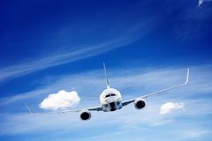 Airplane flying. A big passenger or cargo aircraft Royalty Free Stock Photos