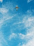 Airplane flying in blue sky Royalty Free Stock Image