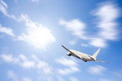 An airplane flying in the blue sky Royalty Free Stock Images