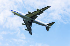 Airplane flying at blue sky Stock Photos
