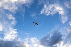 Airplane flying on blue sky. Business travel Royalty Free Stock Photo