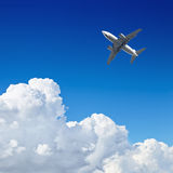 Airplane flying in the blue sky Royalty Free Stock Image