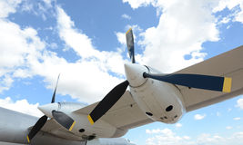 Airplane flying in blue sky with clouds Stock Photos