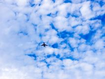 Airplane flying in the blue sky with clouds. Tel-Aviv, Israel stock photo