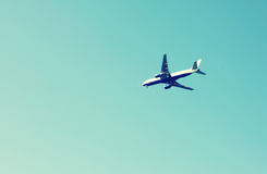 Airplane flying in the blue sky Royalty Free Stock Photo