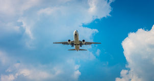 An airplane flying in the blue sky Stock Image
