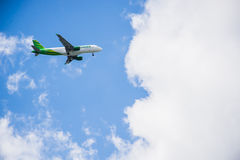 Airplane flying blue sky Stock Photography