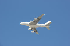Airplane flying on Bright Blue Sky Royalty Free Stock Image