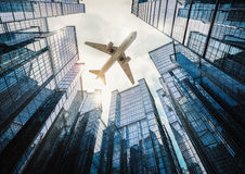 Airplane flying in city. 3d rendering airplane flying above high rise building Royalty Free Stock Photos