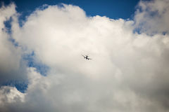 Airplane. Flying in the clouds Royalty Free Stock Image