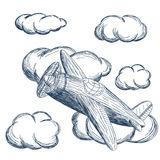 Airplane flying in the clouds stock photography