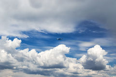 Airplane flying through clouds Royalty Free Stock Photography