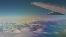 Airplane flying into the clouds. view through an airplane window. traveling stock footage