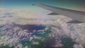 Airplane flying into the clouds. view through an airplane window. traveling stock video footage