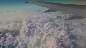Airplane flying into the clouds. view through an airplane window. traveling stock video