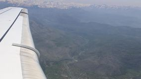 Airplane flying into the clouds. view through an airplane window. traveling b stock footage