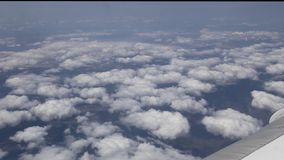 Airplane flying into the clouds. view through an airplane window. traveling b stock video