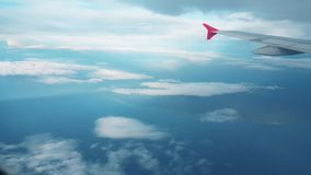 Airplane flying into the clouds, view from the window stock video footage