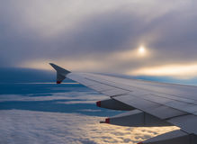 Airplane flying on a cloudy sky Stock Images