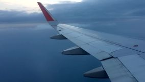 Airplane flying at cruising altitude stock footage