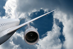 Airplane flying down Royalty Free Stock Photo