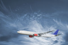 Airplane flying in dramatic sky Stock Photography