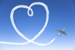 Airplane flying with the heart shape stock photos