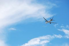 Airplane flying high Royalty Free Stock Photo