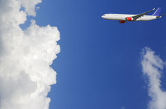 Airplane flying high above the clouds Royalty Free Stock Images