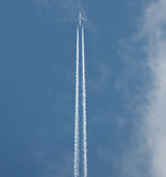 Airplane flying at high altitude Royalty Free Stock Image