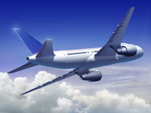 Airplane flying high Stock Photography