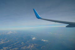 Airplane flying high in the sky Stock Images